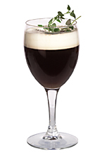 Picture of the CeeDee drink; made from gin, Kahlua, orange liqueur, hot coffee and whipped cream, and served in a white wine glass.