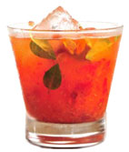 Basil Acerola Caipirinha - The Basil Acerola Caipirinha drink is made from Leblon Cachaca, acerola, basil and sugar, and served in an old-fashioned glass.
