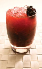 Blackberry Caipirinha - The Blackberry Caipirinha drink is made from Leblon Cachaca, lime, blackberries and sugar, and served in an old-fashioned glass.