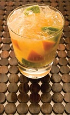 Citrus Twist - The Citrus Twist drink is made from cachaca, passionfruit flavored coconut water, lemon-lime soda, orange and lime, and served in an old-fashioned glass.