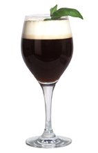 Mandarine Coffee - The Mandarine Coffee drink is made from Mandarine Napoleon, hot coffee and cream, and served in a white wine glass.