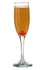 The Mimosa drink is made from orange curacao, orange juice and champagne, and served in a champagne flute.