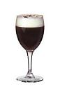The Saint Brendans Irish Coffee drink is made from Irish Cream (Saint Brendan's) and fresh coffee, and served in a white wine glass.